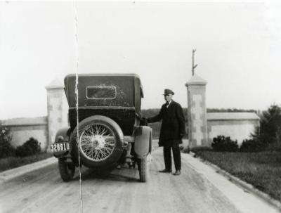 Frank D. Lindley, Joy Morton's chauffeur, at old Thornhill entrance gates