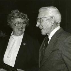 Clarence E. Godshalk's 90th birthday celebration scrapbook: Barbara Tyznik talking with Clarence Godshalk
