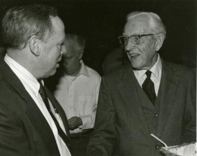 Clarence E. Godshalk's 90th birthday celebration scrapbook: Charles Haffner talking with Clarence Godshalk