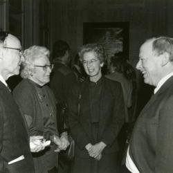Clarence E. Godshalk's 90th birthday celebration scrapbook: Marion T. Hall, Margaret Godshalk, Virginia Hall, and Charles Haffner talking with one another