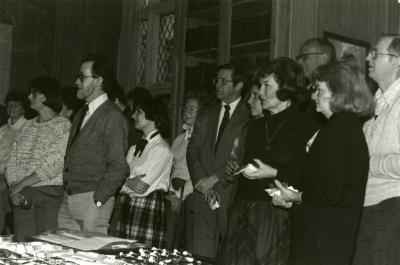 Clarence E. Godshalk's 90th birthday celebration scrapbook: guests listening to speaker