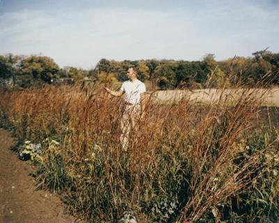 Ray Schulenberg in fall prairie with big bluestem