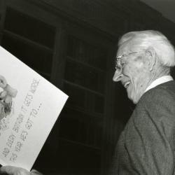 Clarence E. Godshalk's 90th birthday celebration scrapbook: Clarence Godshalk enjoying his birthday card