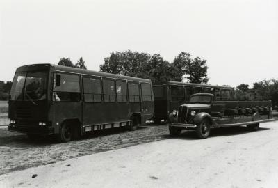 """Open-air touring bus next to new enclosed bus called """"Big Brown"""""""