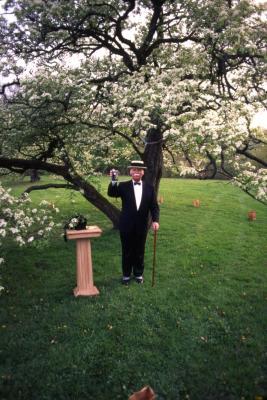 Twilight Tree Walk, Craig Johnson dressed as Joy Morton, holding up Morton Salt canister next to stand