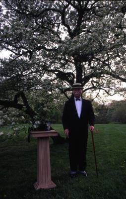 Twilight Tree Walk, Craig Johnson dressed as Joy Morton, standing next to Morton Salt canister on stand