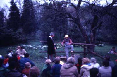 Round Meadow Candle Walk, performance in front of crowd and campfire