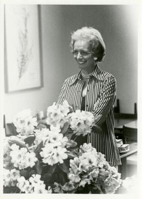 Helen Langrill behind bouquet of flowers
