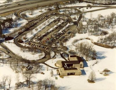 Aerial view of Visitor Center & Main Parking Lot in winter