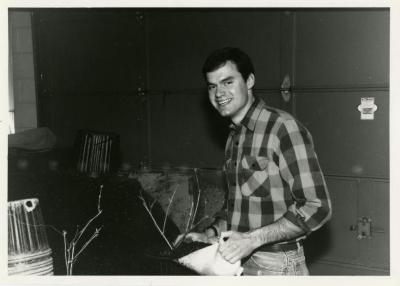 Peter Linsner preparing plants inside