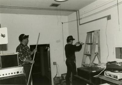 Dennis Liby and assistant working in Thornhill Audubon Room projection booth