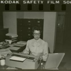 Kathy McNulty in office (contact print)