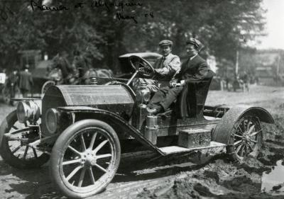 Sterling Morton driving automobile with man for premier at Algonquin