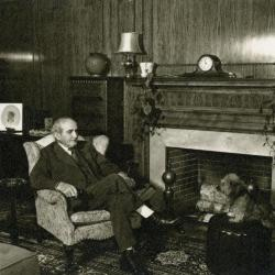 Mark Morton Christmas Card, sitting by fireplace at his residence on North Ave.
