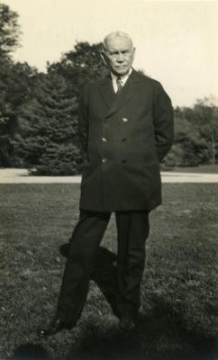 Joy Morton September 27, 1930 photo album: Joy Morton standing in lawn