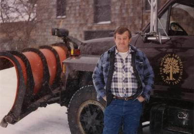 Doug Monroe with Arboretum vehicle in winter
