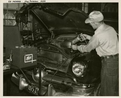 Ed Meyers working on a car in the shop