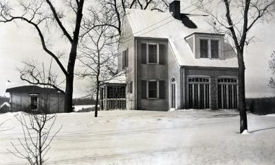 Clarence Godshalk's first Arboretum house and yard in winter, south side
