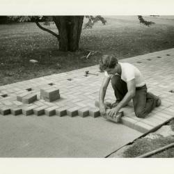 Scott Moberg laying bricks for the Display Garden path