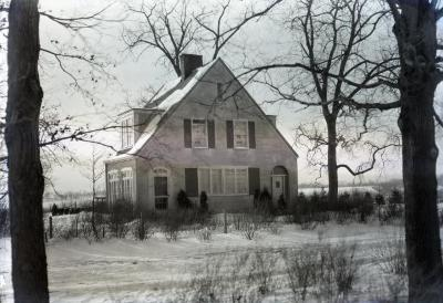 Clarence Godshalk's first Arboretum house in winter, front exterior view, facing on old Joliet Road
