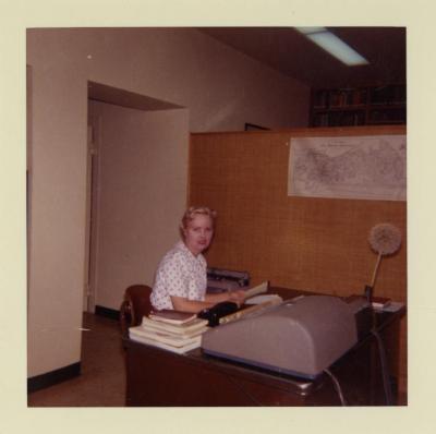 Evelyn Naser at typewriter in office