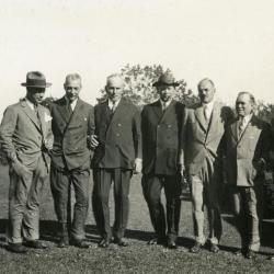 Joy Morton September 27, 1930 photo album: Joy Morton standing with group of men