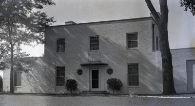 Clarence Godshalk's second Arboretum house, exterior front view with dog in lawn near walkway