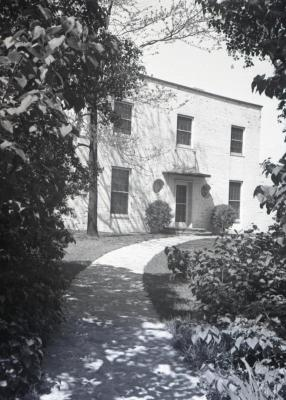 Clarence Godshalk's second Arboretum house, view from end of curved walk to front door