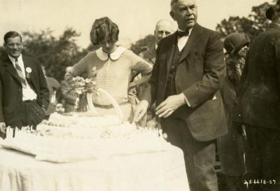 Joy Morton's 70th Birthday: Joy Morton cutting cake with Suzette