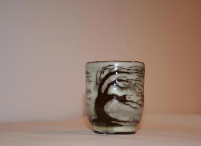 small ceramic container with brown under glazed and windblown tree design