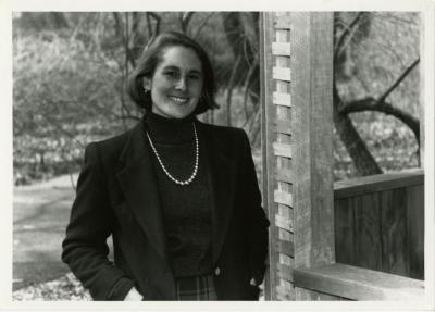 Annette Rossi outside, standing next to wooden structure