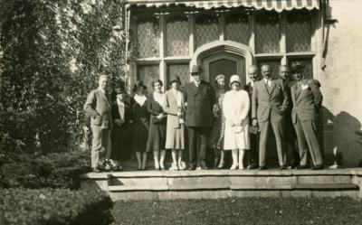Joy Morton September 27, 1930 photo album: Joy Morton and group standing together in front of Thornhill residence