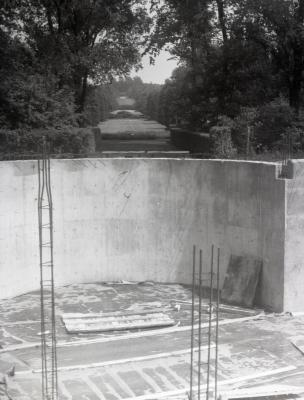Construction for Cudahy and Rotunda addition to the Administration Building, cement foundation for rotunda overlooking Hedge Garden