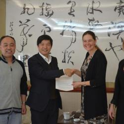 Nicole Cavender and Murphy Westwood meeting with colleagues from the Beijing Botanical Garden in China