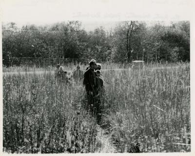Ray Schulenberg in prairie with group