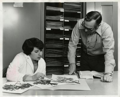 Ray Schulenberg in Herbarium with Kathy Ciolac studying specimen