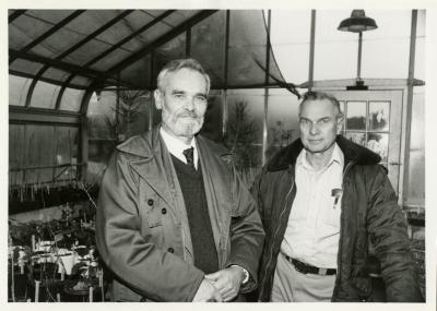 Ray Schulenberg in greenhouse with other person