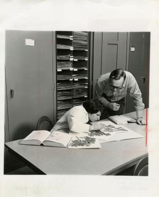 Ray Schulenberg with Kathy Ciolac studying specimens in Herbarium