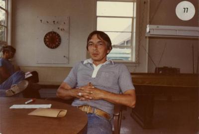 John Sosnowski seated at table in break room