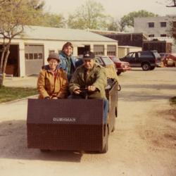 Horticultural crew riding in Cushman at South Farm
