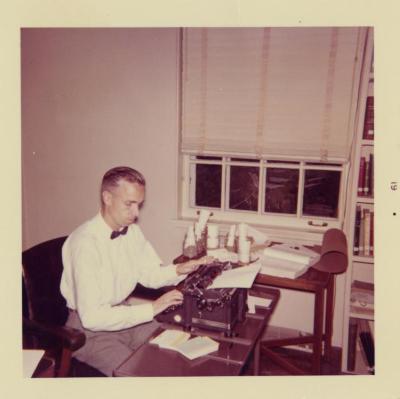 Floyd Swink in office at typewriter