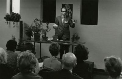Floyd Swink instructing class in a classroom