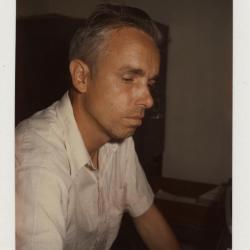Floyd Swink in office, side profile