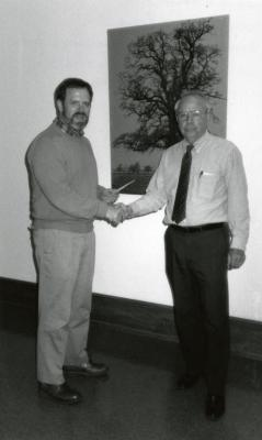 George Ware receiving Chevron Co. check for $8,000 supporting paper by Chris Whelan and Marlin Bowles