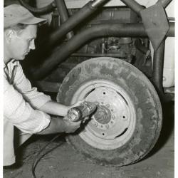 Tony Tyznik removing tire lug nuts