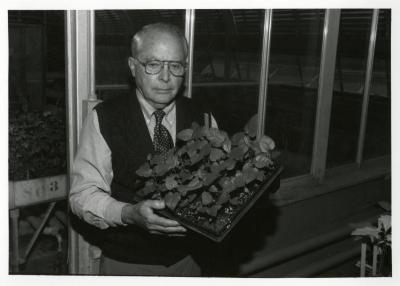 George Ware holding seedlings from China Collection