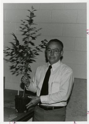 George Ware holding plant indoors