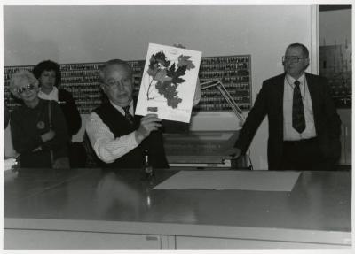 Dr. George Ware with 100,000th Herbarium specimen