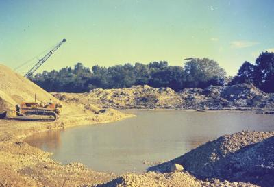 Arbor Lake excavation, man operating equipment to the left of partially filled lake