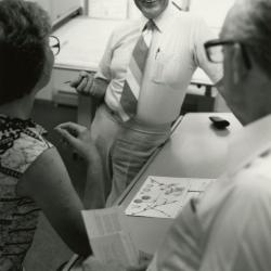 Tony Tyznik with woman and man in office